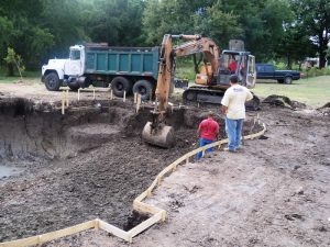 hauling-dirt-during-pool-construction